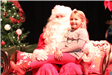 girl sitting on santa's lap