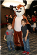 two kids posing with rudolph