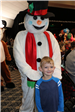 kid posing with frosty the snowman