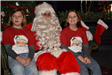 two girls sitting with Santa