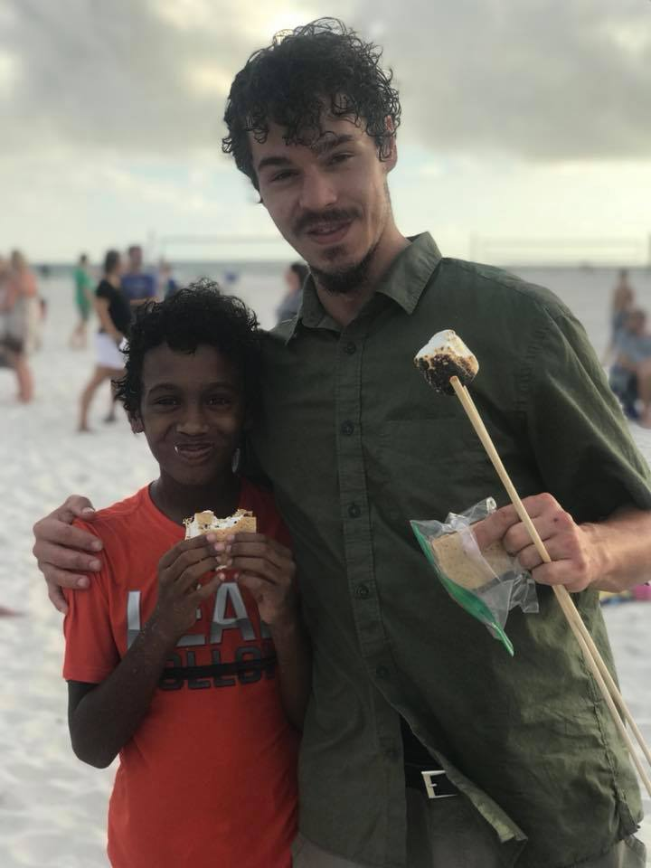 father and son eating smores