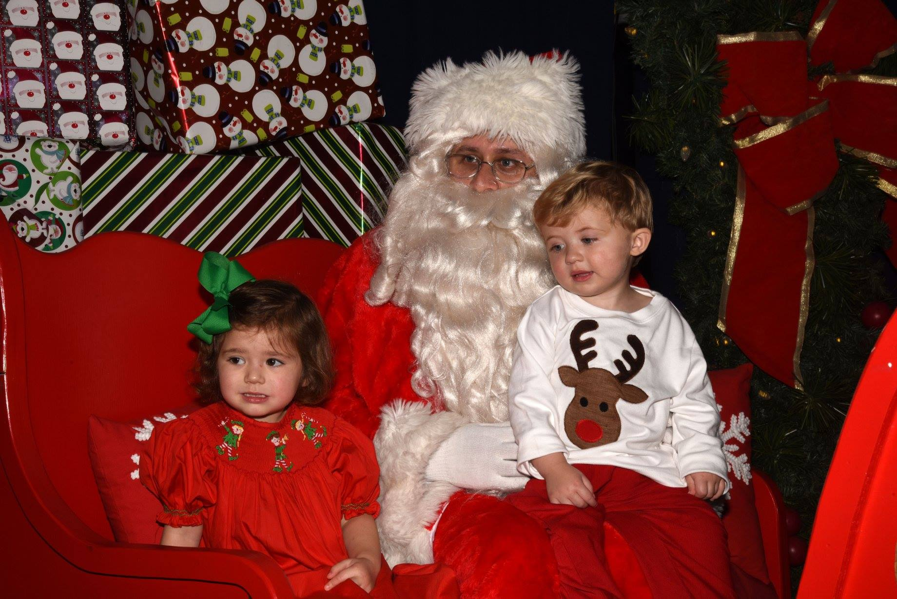 two girls sitting on Santa's lap