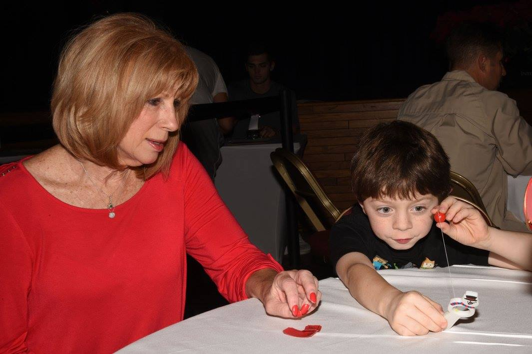 mom and son doing crafts