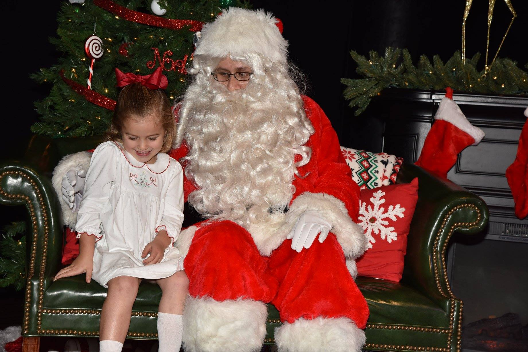 child sitting with Santa
